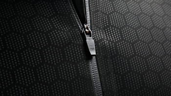 Ceramic particles bound together in a honeycomb formation on the Condition Black Ceramic Baselayer. See more at vollebak.com